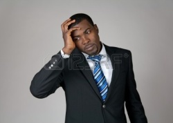 10763847-business-going-wrong-african-american-businessman-looking-frustrated