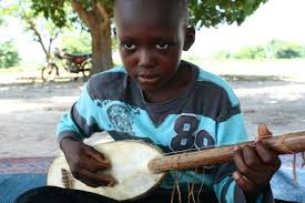 imagesAfrican boy playing stringed instrument